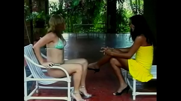 Latin-American transvestite with black hair licks pussy of blonde and drilled her